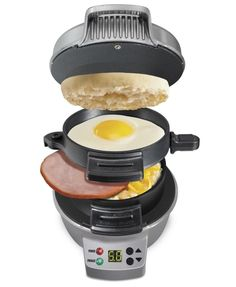 """Promising Review: """"I must admit I thought this seemed gimmicky — UNTIL I tried it. Super easy to use, easy to wipe up, and makes a delicious piping-hot breakfast sandwich every time. So fun to dream up new variations. Come up with your toppings as it heats, let it cook for five minutes, and voila, breakfast is ready! We use it almost every day now. The only con I can think of is that it doesn't fit a full-size bagel. Guess we'll get the mini bagels instead. Crumpets work fine and if you cut…"""