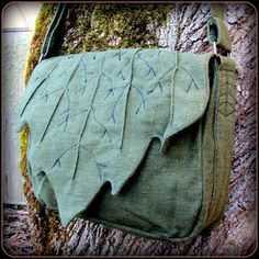 Leaf bag purse in cotton and canvas. Messenger book bag style. Works great as a cross-body bag. Main compartment is 12 across, expands to about