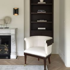Love the wall sconce, wood floors and built-in bookcase without wide traditional wood trim | Canadian interior designer Nam Dang Mitchell