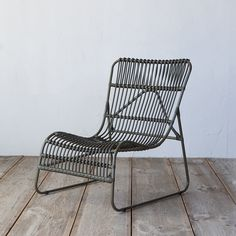 """Made from durable, all weather wicker with a lightweight aluminum frame, this curved chair is a laid-back addition to garden rooms.- Powder-coated aluminum, round poly rattan- Indoor or outdoor use- Clean periodically with mild soap and water- Seat: 14.2""""H, 19.7""""D - Imported31.1""""H, 24.4""""W, 29.9""""DOnline Exclusive"""