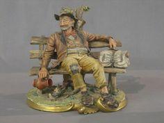 capodimonte | Lot No 546 A Capo di Monte figure of a Tramp reclining on a park bench ...