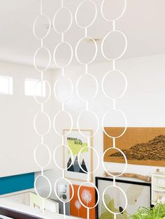 Screen Saver ~ Here, a circle-motif decorative screen separates the living area from the entryway. See-through elements add architectural division without heavy construction or blocked views.