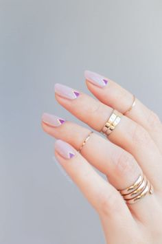 If you like to combine your girly side with a bit of edge, try this geometric moon manicure that combines pretty pastels with bold metallics. See more at So Nailicious »