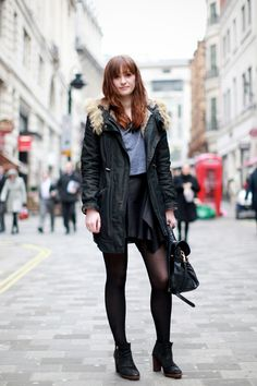 We Snapped The 17 Most Stylish Londoners On Oxford Street #refinery29  http://www.refinery29.com/london-street-style#slide3  Name: Anna Occupation: Intern at Vivienne Westwood press office Hood: Barnet What she's wearing: ASOS T-shirt, Vivienne Westwood skirt, Mulberry bag, Ted Baker parka, and New Look boots.