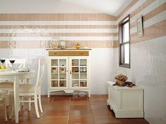 terracotta tiled floor, not sure about the wall tiles.