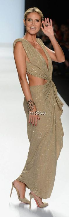 Heidi Klum wearing an Alexandre Vauthier dress, Christian Louboutin shoes & Lorraine Schwartz jewelry on the runway at the Project Runway Spring 2013 fashion show during Mercedes-Benz Fashion Week