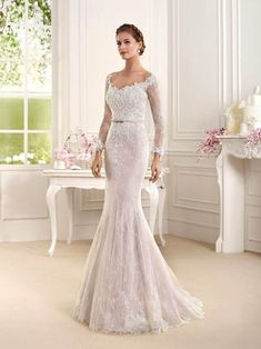 A blush mermaid wedding dress with fitted lace sleeve and thin belt - Dress: Fara Sposa 2016 Collection