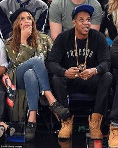 Sitting on the sidelines: Music's most powerful couple sat front row among the star-studded audience at the NBA All-Star game in New York City