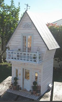It is a shabby chic doll's house!!!http://libertybiberty.blogspot.com/2010/06/outside-shabby-house.html