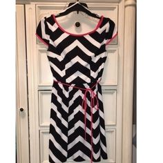 B. Darlin chevron dress Worn twice. Black and white chevron dress with red belt tie and lining. V shaped back. B. Darlin Dresses