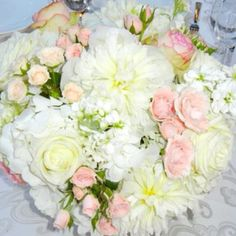 Ivory and coral wedding flowers
