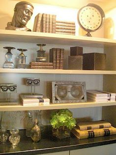Displaying a bookcase/ Stack books horizontally and vertically on shelves for added interest. Layer small pieces, sculpture and a few unusual statement pieces in an eye pleasing arrangement.