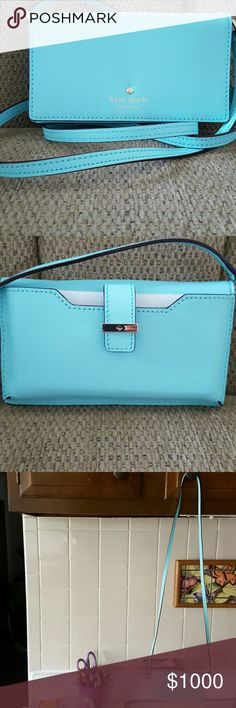 """HUMP DAY SALE.                KATE SPADE CROSSBODY Nwot.   This cute little crossbody is made to carry your phone, I'd card, credit cards and cash.  The long strap snaps on . It can be removed to carry in purse.  Saffiano leather .  Aqua Blue in color + gold hardware   Body is sz. 6 1/4"""" x 3 1/2"""" When closed     And sz. 6 1/4"""" x 7 1/2""""  when opened   Phone part on back is sz. 6 1/4 long x 3 1/2"""" tall   IPHONE 6 Purse drop as crossbody is 22 """" kate spade Bags Crossbody Bags"""