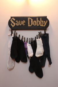 Harry Potter mismatched sock keeper for the laundry room. I kinda love it!