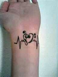 Heartbeat tattoo. The heart is made of a Treble Clef and a Base Clef.   ( When i get older i wabt that tattoo