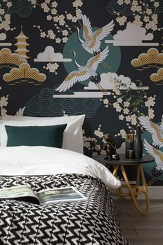 Dark and luxurious tones of emerald green emerge from this decadent oriental wallpaper design. Pair with black and gold accessories to complete the look, and create a sumptuous bedroom space of your own.
