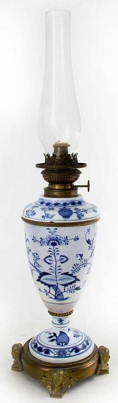 lighting, Germany, A Meissen porcelain oil lamp in the Egyptian Revival taste,  Blue Onion pattern urn form with bronze mounts and Pharaoh's mask feet and glass, hurricane shade. CIrca 1850-1900