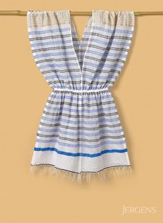 For a beach cover up, go for striped thin cotton that feels weightless and cool, like this terrific tunic from Lemlem.