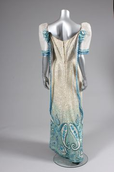 Ramon Valera sequined and beaded gown or `Terno', Philippines, 1960s, the iridescent sequined ground adorned to the hem with blue and white sequins and beads in swirling Paisley motifs, with babarahin stiffened `butterfly' sleeves and gauze over-panel edged in blue beads and droplets, rosettes to the shoulders Ramones, Baro't Saya, Barong, Filipiniana, Beaded Gown, Blue Beads, Couture Dresses, Beautiful Outfits, Paisley