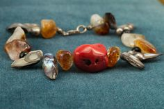 Freshwater Pearl, Black Onix, Yellow Citrine and Red Foam Coral Bracelet with sterling silver clasp.  Length is approximately 20 cm.  More bracelets