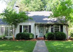 white house, pale blue front door, black shutters