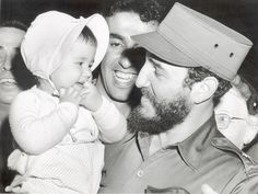 FIDEL CASTRO, Cuban Prime Minister, makes friends with 16-month old Sherry Robin Hayes, of Washington D.C., on a walk through Meridian Hill Park during his 11 day goodwill visit to win US support for his revolutionary regime, c. 1959