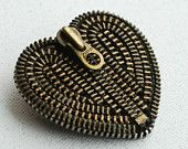 Made from recycled vintage zippers, it's a brooch.