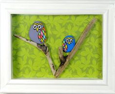Colourful birds hand painted onto pebbles, sitting on driftwood branches with a leafy background Comes ready to hang in a 5 x 7 frame (outside