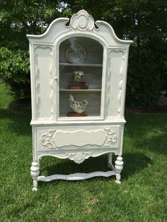 Painted vintage china cupboard.  Used Annie Sloan Old White Chalk paint.