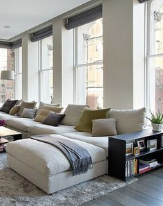 Big comfy white sectional + wall of windows = dream loft!