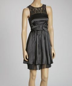 This Black Ruffle Bow Sleeveless Dress is perfect! #zulilyfinds Gorgeous Dress with lace upper and terrific tie waist & sheer rippled lace border at the bottom.