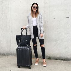 aldo_shoes: Traveling from LA to Florida beaut @thriftsandthreads is plane-ready in her long sweater black skinny jeans and our PALSE sneakers with cute velcro straps... you know for extra comfort. #regram