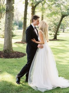 """Bride wears #THEIA """"Harlow"""" gown and """"Elsa"""" overskirt.... Can't see the front, but love the shape of the skirt and from what I can see, the detail on the top - RG"""