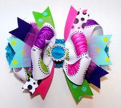 Wild About Fashion Over The Top Bow on by loveablebabyboutique, via Etsy.