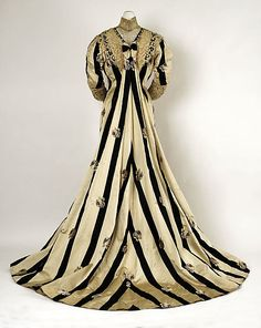 Black and white striped silk tea gown with embroidered roses and lace trim (back), by Campbell & Burke, American, ca. 1900.