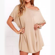 """NWT TShirt Dress Never worn! Super cute and soft taupe T-shirt dress! Can be worn off the shoulders! Lower in the back. Size fits small/medium, but unfortunately it is not meant for us petite gals  I'm 5'1"""" and it sits just a little to long for my liking. Wish that wasn't the case because I love this dress! Dresses"""
