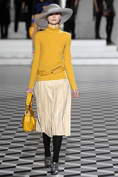 From one of my favorite ever Marc Jacobs collections - Fall 2007 (going through my files!). I bought a pair of buttery leather gloves just that shade of yellow at the leather market in Florence this weekend!