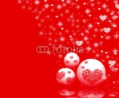 Christmas ornaments and hearts on red