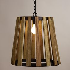 Add a rustic look to your decor with our exclusive open pendant, fashioned of mango wood slats into a silhouette reminiscent of a vintage apple basket. Accented with metal in an aged black finish for a touch of industrial styling, this unique pendant looks great paired with our vintage-style Edison filament bulb.