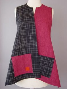 Long Round Neck Vest with Abstract Shapes and Teal Accent | love these descriptions. Don't see teal here, but orange.