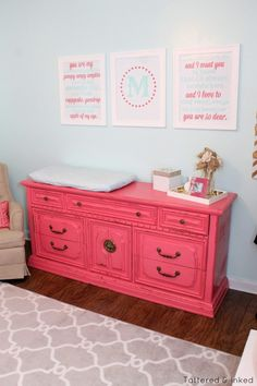 Pink Vintage Dresser Turned Changing Table - what a fun pop of color in this baby girl nursery!