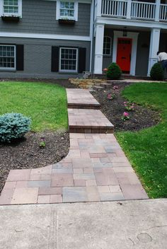 Concrete walkway capped with pavers