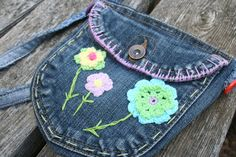 I made this little bag out of 2 jeans pockets. Its lined with cute flowery cotton cloth with a snap for a closure. The inside is one section, and both
