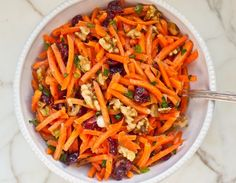 Carrot Slaw with Cranberries, Toasted Walnuts & Citrus Vinaigrette Classic French grated carrot salad, and this is a delicious spin on it. With dried cranberries, toasted walnuts and scallions in a citrus vinaigrette. Grated Carrot Salad, Carrot Slaw, Barley Salad, Soup And Salad, Vegetable Recipes, Vegetarian Recipes, Healthy Recipes, Healthy Lunches, Vegan Meals