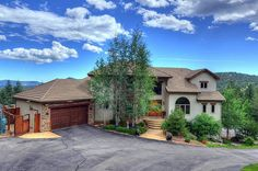 Equestrian Estate for sale in Jefferson County in Colorado. Lovely & spacious custom home built in 2004, with privacy and expansive mountain views, on 12+ acres of horse property. Recently appraised at $1,550,000. Beautiful views everywhere (and even a few twinkling city lights at night) and a tremendous feel of privacy, especially from the oversized deck.