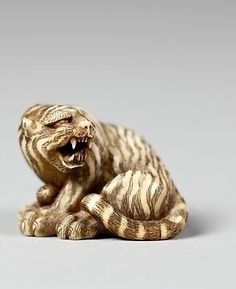 Netsuke of Tiger with Head Turned, ivory, 19th century. Japan. The Met.
