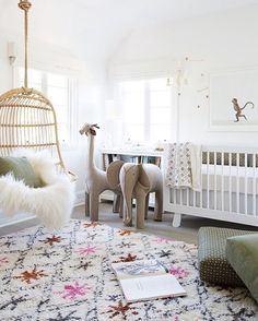 in Erin Fetherston's nursery Cozy nursery with a colorful rug, a hanging chair with a faux fur, stuffed animals and a white children's bed.Cozy nursery with a colorful rug, a hanging chair with a faux fur, stuffed animals and a white children's bed. Baby Boy Nursery Decor, Baby Bedroom, Baby Boy Rooms, Nursery Neutral, Baby Boy Nurseries, Nursery Room, Kids Bedroom, Nursery Ideas, Kids Rooms