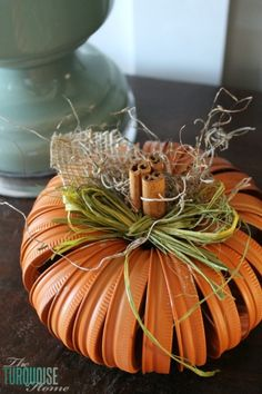 Turquoise and Orange Fall Home Tour | TheTurquoiseHome.com. I love the pumpkin made of mason jar lids. It's not a tutorial but you can reference the picture.