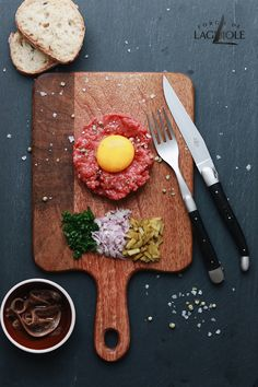 Beef tartare, anyone? Delight your family and friends at the weekend with this excellent dish. Our Forge de Laguiole® cutlery is the ideal complement! Pictures are our table knife and fork in a satin finish with an Ebony handle. #beef #beeftartare #tablesetting #knife #knives #cutlery #design #tableware #knifemaking #craftmanship #easyrecipe #lunchideas #dinnerideas #laguiole #steakknife #laguioleknife #laguioleknives #forgedelaguiole #steaktartare #madeinfrance #handmade