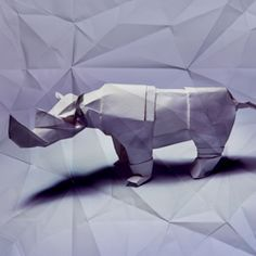 Photographed origami pieces layered with paper texturing
